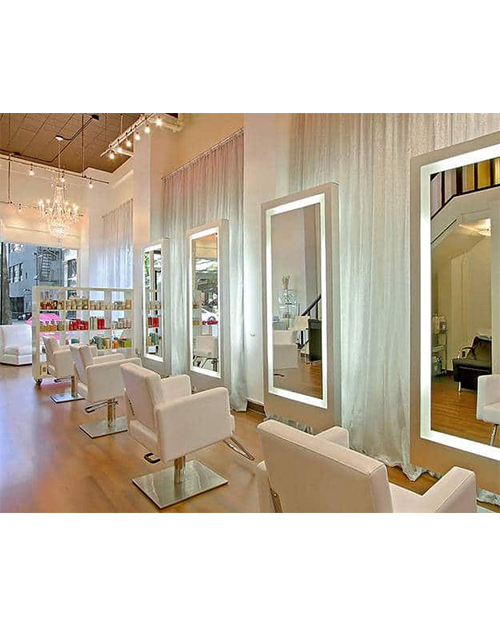 in-this-glam-salon-sheer-silver-fabric-curtaining-the-walls-brings-an-iridescent-shimmer-to-the-room-and-adds-a-soft-touch-to-illuminated-freestanding-mirrors